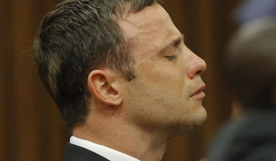 Oscar Pistorius reacts in the dock as Judge Thokozile Masipa delivers her verdict during his murder trial in Pretoria, South Africa, Thursday Sept. 11, 2014. Masipa ruled out a murder conviction for the double-amputee Olympian in the shooting death of his girlfriend, Reeva Steenkamp, but said he was negligent, raising the possibility he'll be convicted of culpable homicide. (AP Photo/Kim Ludbrook, Pool)