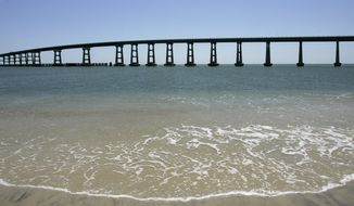 FILE- In this May 14, 2007, file photo, the Bonner Bridge spans the Oregon Inlet south of Nags Head, N.C. The state Transportation is delaying construction of a bridge at Pea Island until the court case involving the longer span to the north, the Bonner Bridge, is settled. (AP Photo/Gerry Broome, File)