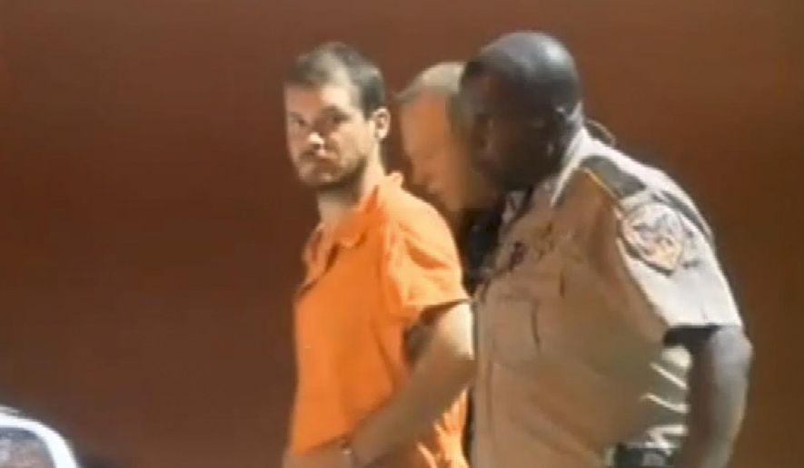 In this image taken from video on Tuesday, Sept. 9, 2014, Smith County Sheriff's Deputies escort Timothy Ray Jones Jr., from jail in Raleigh, Miss. Jones, of Lexington County, S.C., is expected to be extradited back to South Carolina on Wednesday, Sept. 10, 2014, and charged with murder in the deaths of his five children after he led authorities to a secluded clearing in Alabama on Tuesday, where their bodies were found wrapped in garbage bags. (AP Photo/WLBT, Tegre Taylor)  JACKSON, MISS., OUT: LOCAL TV OUT: LOCAL ONLINE OUT: LOCAL MEDIA OUT: MANDATORY CREDIT.