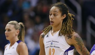 Phoenix Mercury center Brittney Griner (42) walks to the bench after getting a cut above her eye during the first half of  Game 2 of the WNBA basketball finals against the Chicago Sky, Tuesday, Sept. 9, 2014, in Phoenix. (AP Photo/Matt York)