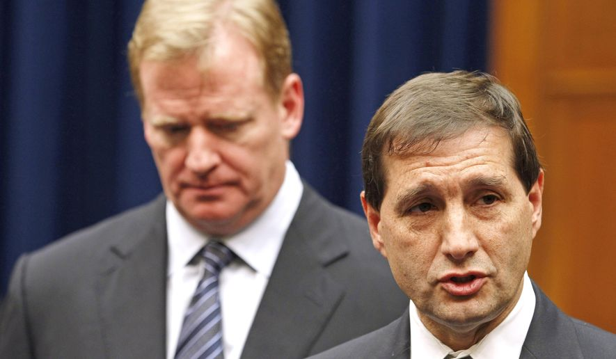 """FILE - In this Oct. 14, 2011, file photo, NFL football lead counsel Jeff Pash, right, accompanied by NFL Commissioner Roger Goodell, speaks with reporters on Capitol Hill in Washington, after a meeting to discuss HGH testing for NFL players. The two NFL owners overseeing the investigation into how the league pursued and handled evidence in the Ray Rice domestic violence case pledged Thursday, Sept. 11, 2014 to make the findings of the probe public, and said their goal was """"to get the truth."""" (AP Photo/Haraz N. Ghanbari, File)"""