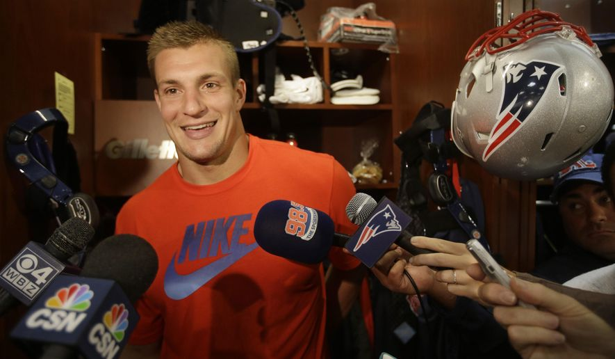 New England Patriots tight end Rob Gronkowski talks with members of the media while standing in front of his locker during a media availability at the NFL football team's facility Thursday, Sept. 11, 2014 in Foxborough, Mass. (AP Photo/Stephan Savoia)