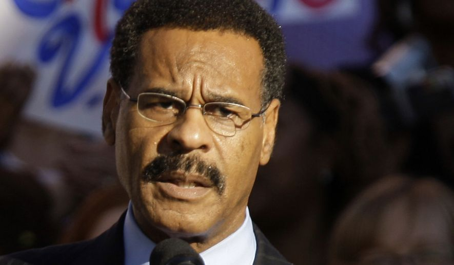 Missouri Democratic U.S. Rep. Emanuel Cleaver speaks at a rally in Kansas City, Missouri, in this Oct. 1, 2008, file photo. Federal investigators are looking into what appears to have been an early morning attempt Thursday, Sept. 11, 2014, to firebomb Cleaver's Missouri office. (AP Photo/Charlie Riedel, File)