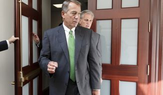 House Speaker John Boehner of Ohio, left, and House Majority Leader Kevin McCarthy of Calif., emerge from a two-hour, closed door meeting on Capitol Hill in Washington, Thursday, Sept. 11, 2014, with fellow Republicans to consider the proposals from President Barack Obama to combat Islamic State militants in the heart of the Middle East. (Associated Press) **FILE**