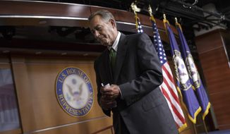 House Speaker John Boehner of Ohio leaves after a news conference on Capitol Hill in Washington, Thursday, Sept. 11, 2014, to respond to the proposals from President Barack Obama about confronting the new wave of terrorism. On the anniversary of the 9/11 attacks, Republicans and Democrats in Congress voiced strong pre-election support Thursday for President Barack Obama's call for new authority to combat Islamic State militants in the heart of the Middle East. (AP Photo/J. Scott Applewhite)