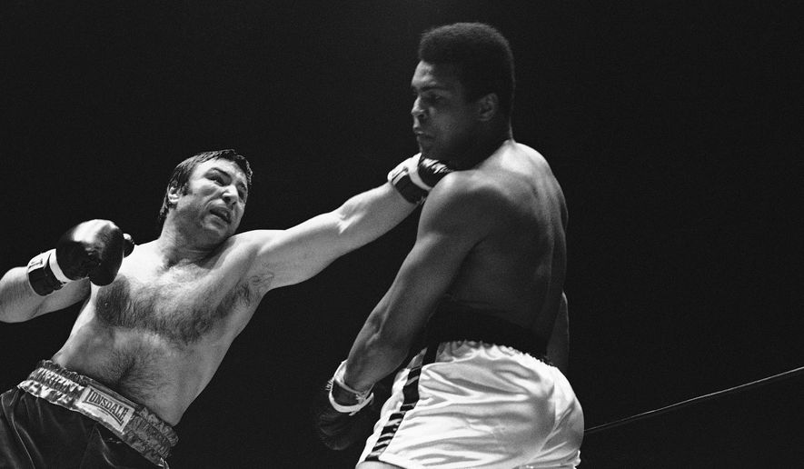 FILE - In this May 1, 1972, file photo, George Chuvalo connects with a left to the head of Muhammad Ali in the first round of their scheduled 12-round fight in Vancouver. Chuvalo understands that these are tough times for his sport, some of the interest siphoned off by mixed martial arts. But he thinks some riveting heavyweights can change that. (AP Photo/File)