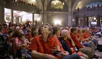 Abortion opponents fill the Missouri Capitol rotunda Wednesday, Sept. 10, 2014, in Jefferson City, Mo. Missouri lawmakers will consider whether to override a veto by Gov. Jay Nixon of legislation requiring a 72-hour waiting period for abortions, one of the longest mandatory delays in the nation, during a special legislative session that begins Wednesday. (AP Photo/Jeff Roberson)