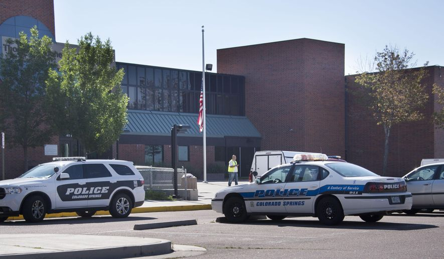 Doherty High School in Colorado Springs, Colo. was closed Thursday, Sept. 11, 2014, and students sent home after a teen male was found dead inside the school at 7:30 am. No foul play was suspected, police said.  Doherty High School Principal Kevin Gardner did not confirm the dead teen was a Doherty student. (AP Photo/The Colorado Springs Gazette, Mark Reis)