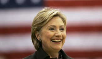 """FILE - In this Dec. 31, 2007, file photo, then-Democratic presidential hopeful Sen. Hillary Rodham Clinton, D-N.Y., smiles while speaking at a campaign stop at Muscatine West Middle School in Muscatine, Iowa. Clinton last left Iowa on an """"excruciating"""" night, the beginning of the end of her White House campaign. She returns for the first time this weekend, not quite yet running for president, but sure to hear cheers from a crowd of Democrats hoping she will. (AP Photo/Jeff Chiu, File)"""