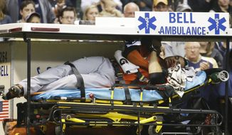 Miami Marlins' Giancarlo Stanton is taken off the field on a stretcher after being hit in the face with a pitch during the fifth inning of a baseball game against the Milwaukee Brewers Thursday, Sept. 11, 2014, in Milwaukee. (AP Photo/Morry Gash)