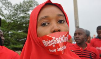 A woman attends a demonstration in Abuja, Nigeria, Thursday Sept. 11, 2014, calling on the government to rescue the kidnapped girls of the government secondary school in Chibok. More than 200 schoolgirls were kidnapped from a school in Chibok in Nigeria's north-eastern state of Borno on April 14. Boko Haram claimed responsibility for the act. (AP Photo/Olamikan Gbemiga)