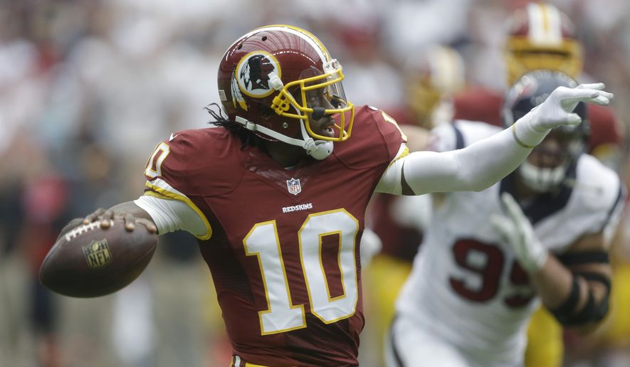 Washington Redskins' Robert Griffin III (10) looks to throw against the Houston Texans during the first quarter of an NFL football game, Texans, Sunday, Sept. 7, 2014, in Houston. (AP Photo/Patric Schneider)