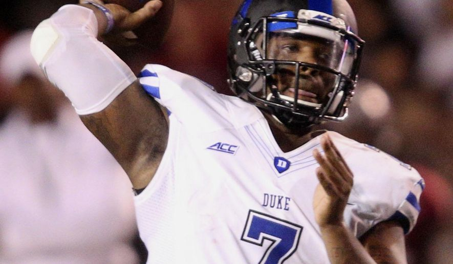 Duke quarterback Anthony Boone (7) looks for an open receiver in the second half of an NCAA college football game at Veterans Memorial Stadium, Saturday, Sept. 6, 2014, in Troy, Ala. (AP Photo/ Hal Yeager)