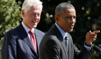 Former President Bill Clinton listens as President Barack Obama speaks on the South Lawn of the White House in Washington, Friday, Sept. 12, 2014, as they marked the 20th anniversary of AmeriCorps, which promotes volunteerism and community service. (AP Photo/Charles Dharapak) ** FILE **