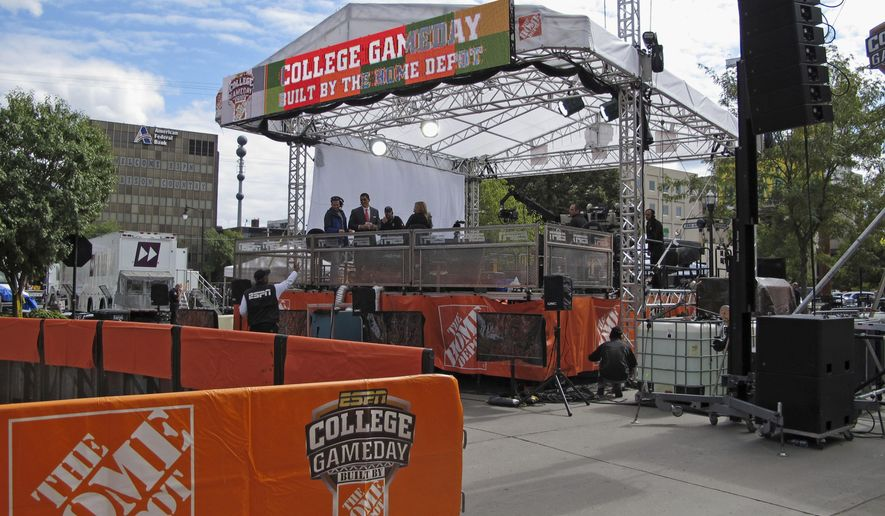 Some members of the ESPN College GameDay show rehearse on the set in downtown Fargo on Friday, Sept. 12, 2014. The show will be broadcast at the home of three-time Football Championship Subdivision winner North Dakota State for the second straight year. (AP Photo/Dave Kolpack)