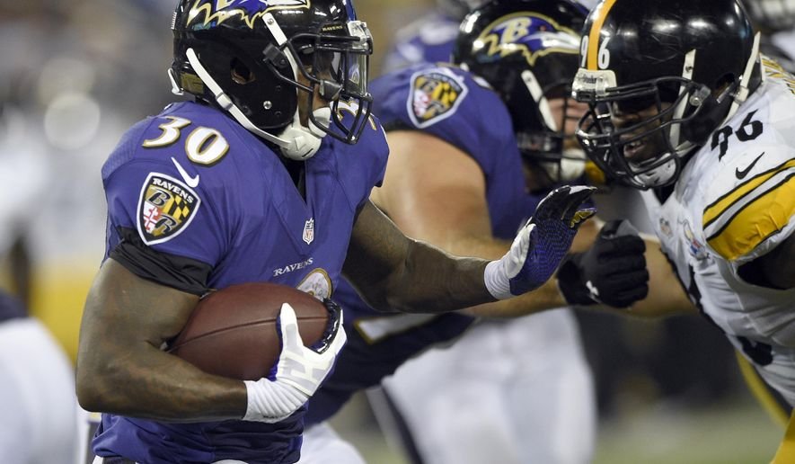 Baltimore Ravens running back Bernard Pierce (30) runs as Pittsburgh Steelers nose tackle Cam Thomas (96) closes in during the second half of an NFL football game Thursday, Sept. 11, 2014, in Baltimore. The Ravens won 26-6. (AP Photo/Nick Wass)