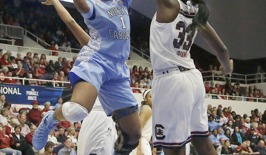 FILE - In this March 30, 2014, file phot, North Carolina forward Stephanie Mavunga (1) shoots against South Carolina center Elem Ibiam (33) during the first half of a regional semifinal game at the NCAA college basketball tournament in Stanford, Calif. (AP Photo/Jeff Chiu, File)