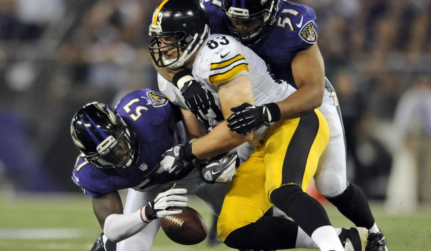 Pittsburgh Steelers tight end Heath Miller (83) fumbles the ball as he is hit by Baltimore Ravens inside linebacker Daryl Smith (51) as inside linebacker C.J. Mosley (57) recovers the ball, during the second half of an NFL football game Thursday, Sept. 11, 2014, in Baltimore. (AP Photo/Gail Burton)