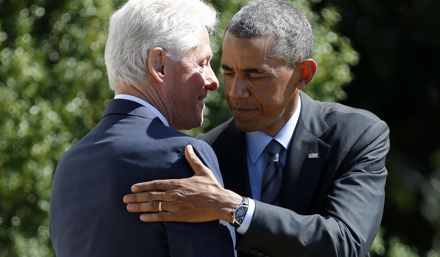 President Barack Obama embraces former President Bill Clinton on the South Lawn of the White House in Washington, Friday, Sept. 12, 2014, after Clinton spoke at an event marking the 20th anniversary of AmeriCorps, which promotes volunteerism and community service. President Barack Obama and former President Bill Clinton joined forces Friday to mark the 20th anniversary of the AmeriCorps national service program, heralding the impact volunteering can have on both individuals and the nation.  (AP Photo/Charles Dharapak)