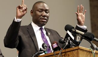 In this Monday, Aug. 18, 2014, file photo, Brown family attorney Benjamin Crump speaks during a news conference in St. Louis County, Mo. (AP Photo/Jeff Roberson, File)