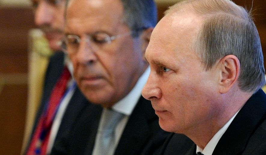 Russian President Vladimir Putin, right, speaks during his meeting with Chinese President Xi Jinping, in Dushanbe, Tajikistan, as Russian Foreign Minister, Sergey Lavrov listens Thursday, Sept. 11, 2014. Putin takes part in the two-day summit of the Shanghai Cooperation Organization, which brings together Russia, China and four former Soviet republics in Central Asia. (AP Photo/RIA Novosti, Mikhail Klementyev, Presidential Press Service)