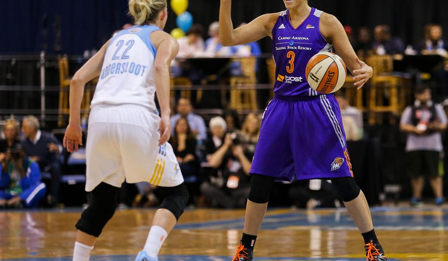 Phoenix Mercury's Diana Taurasi calls to her teammates as Chicago Sky's Courtney Vandersloot defends during the first half of Game 3 of the WNBA Finals basketball series, Friday, Sept. 12, 2014, in Chicago. (AP Photo/Kamil Krzaczynski)