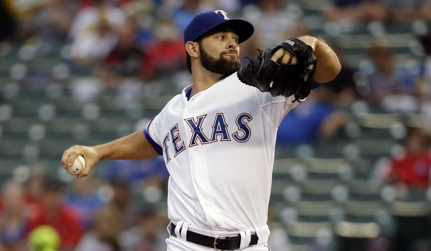 Texas Rangers starting pitcher Nick Martinez works against the Los Angeles Angels in the first inning of a baseball game, Thursday, Sept. 11, 2014, in Arlington, Texas. (AP Photo/Tony Gutierrez)