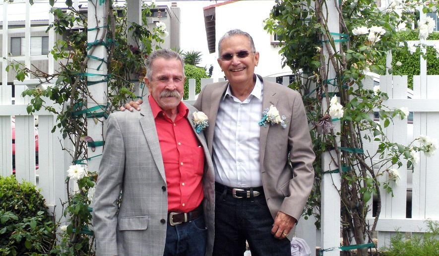 In this July 2014 photo provided by the Lambda Legal Defense and Education Fund Fred McQuire, left, and George Martinez pose for photos at their wedding in California. Martinez was a Vietnam War veteran in the throes of the final stages of cancer when he and McQuire, his partner of 45 years, traveled from Arizona to California to fulfill one of his final wishes and get married. He died Aug. 28, 2014, and now McQuire is in the midst of a legal battle over Arizona's ban on gay marriage. (AP Photo/Lambda Legal Defense and Education Fund)