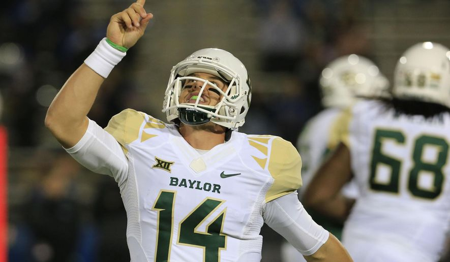 Baylor quarterback Bryce Petty celebrates a touchdown against Buffalo during the third quarter of an NCAA college football game against Buffalo on Friday, Sept. 12, 2014, in Amherst, N.Y. (AP Photo/The Buffalo News, Harry Scull, Jr.)  TV OUT; MAGS OUT; MANDATORY CREDIT; BATAVIA DAILY NEWS OUT; DUNKIRK OBSERVER OUT; JAMESTOWN POST-JOURNAL OUT; LOCKPORT UNION-SUN JOURNAL OUT; NIAGARA GAZETTE OUT; OLEAN TIMES-HERALD OUT; SALAMANCA PRESS OUT; TONAWANDA NEWS OUT