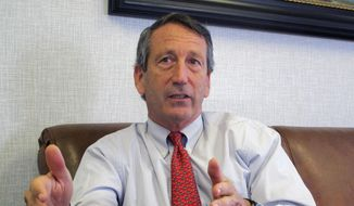 U.S. Rep. Mark Sanford, R-S.C., discusses his first months back in Congress during an Associated Press interview in his district office in Mount Pleasant, S.C., in this  Dec. 18, 2013, file photo. Sanford said on Friday, Sept. 12, 2014, that he and his fiancee are calling off their engagement due to the ongoing contention with his ex-wife Jenny Sanford, four years after their divorce. (AP Photo/Bruce Smith, File)