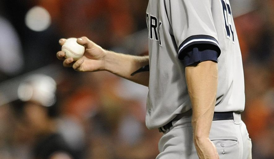 New York Yankees starting pitcher Bryan Mitchell walks to the mound after giving up two runs to the Baltimore Orioles in the fourth inning in the second baseball game of a doubleheader, Friday, Sept. 12, 2014 in Baltimore. The Orioles won 5-0.(AP Photo/Gail Burton)