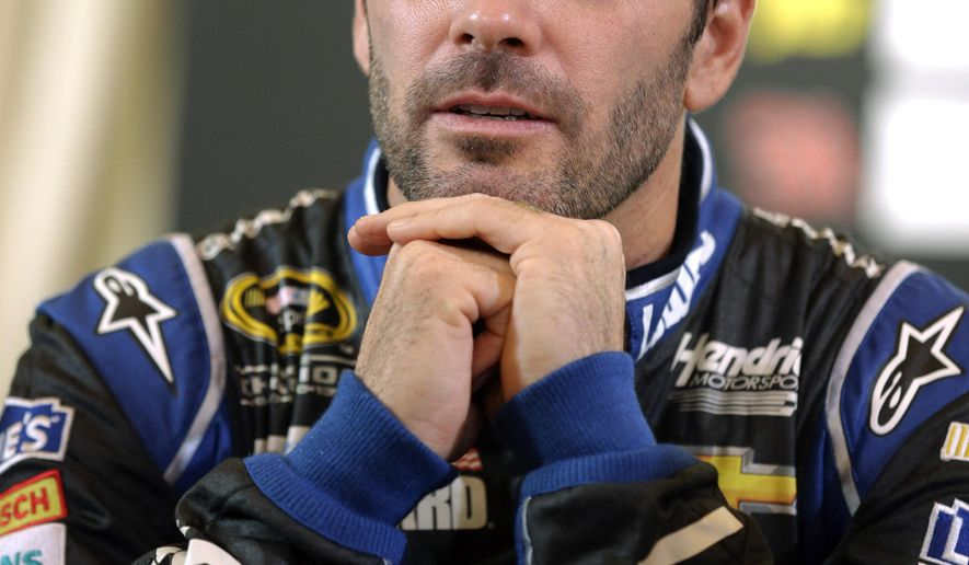 Jimmie Johnson waits for his interview during the NASCAR Sprint Cup media day in Chicago, Thursday, Sept. 11, 2014. The 16 drivers in the Chase for the Sprint Cup championship took part in the event. The opening race in the Chase is at Chicagoland Speedway on Sunday in Joliet, Ill. (AP Photo/Nam Y. Huh)