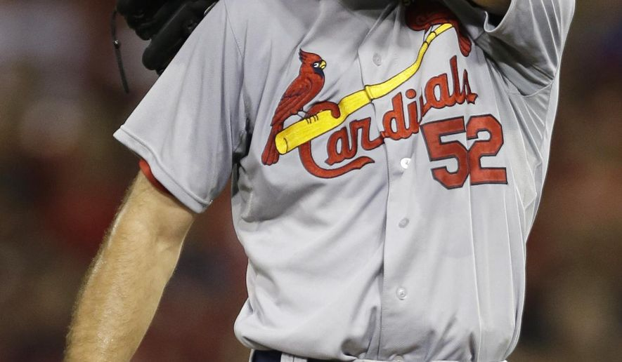 St. Louis Cardinals starting pitcher Michael Wacha wipes his face in the fifth inning of a baseball game against the Cincinnati Reds, Tuesday, Sept. 9, 2014, in Cincinnati. (AP Photo/Al Behrman)