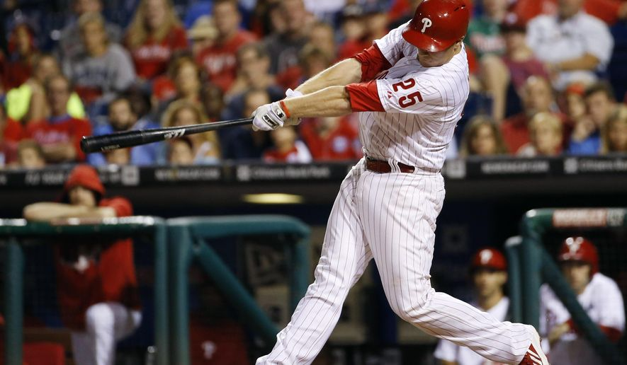 Philadelphia Phillies' Cody Asche follows through after hitting the game-winning two-run home run off Miami Marlins relief pitcher Dan Jennings during the 10th inning of a baseball game, Friday, Sept. 12, 2014, in Philadelphia. Philadelphia won 3-1 in 10 innings. (AP Photo/Matt Slocum)
