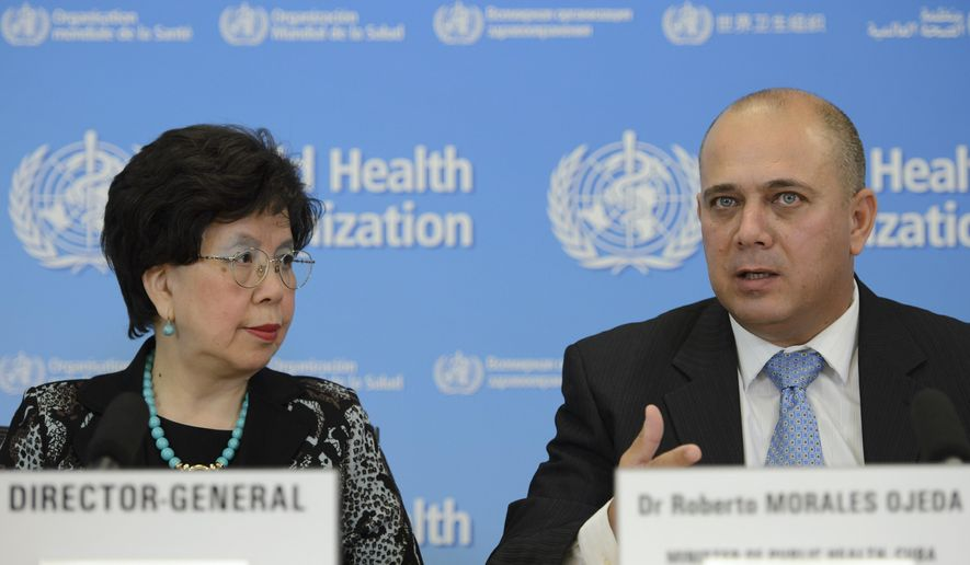 China's Margaret Chan, left, General Director of the World Health Organization, WHO, and Roberto Morales Ojeda, right, Minister of Public Health, Cuba attend a press conference about the support to Ebola affected countries, at the headquarters of the WHO,  in Geneva, Switzerland, Friday, Sept. 12, 2014.   Cuba's health ministry said Friday it is sending more than 160 health workers to help stop the raging Ebola outbreak in Sierra Leone, providing a much-needed injection of medical expertise in a country where health workers are in short supply. (AP Photo/Keystone,Martial Trezzini)