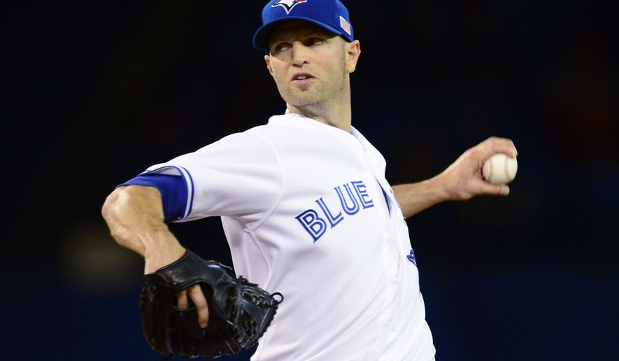 Toronto Blue Jays starting pitcher J.A. Happ throws against the Tampa Bay Rays during the first inning of a baseball game Friday, Sept. 12, 2014, in Toronto. (AP Photo/The Canadian Press, Frank Gunn)