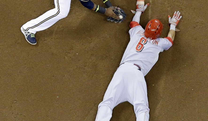 Milwaukee Brewers shortstop Jean Segura tags out Cincinnati Reds' Billy Hamilton as he is caught stealing second during the third inning of a baseball game Friday, Sept. 12, 2014, in Milwaukee. (AP Photo/Morry Gash)