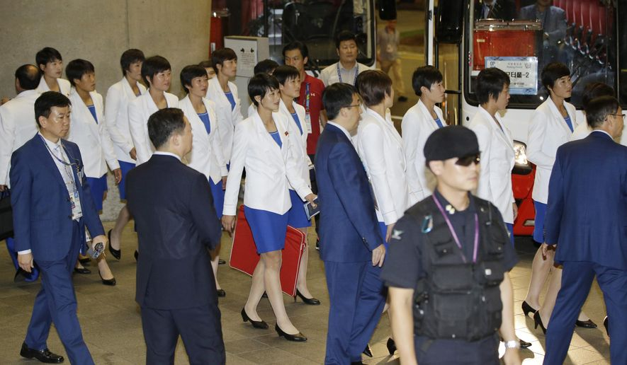 North Korean woman soccer players arrive for the 17th Asian Games at Incheon International Airport in Incheon, west of Seoul, South Korea, Thursday, Sept. 11, 2014. The games will be held in the South Korean west city from Sept. 19 to Oct. 4. (AP Photo/Lee Jin-man)