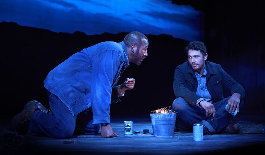 """FILE - This undated file image released by Polk & Co. shows James Franco, right, and Chris O'Dowd in a scene from """"Of Mice and Men,"""" in New York. The recent revival of """"Of Mice and Men"""" starring James Franco may have closed on Broadway but you can still catch it. The play will be screened in over 700 movie theaters across the United States and Canada on Nov. 6, 2014.  (AP Photo/Polk & Co., Richard Phibbs, file)"""