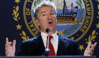 Sen. Rand Paul, Kentucky Republican, endorses Senate hopeful Scott Brown during a campaign event at the University of New Hampshire in Durham, N.H., on Sept. 12. (Associated Press)