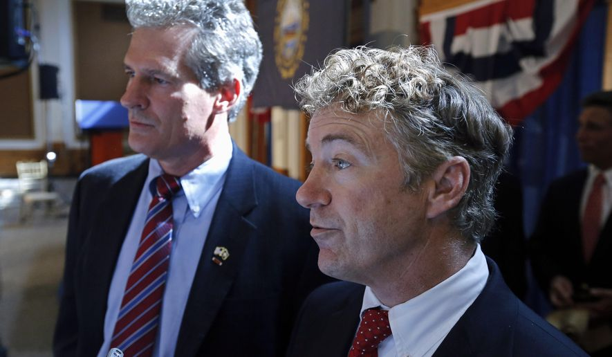 Sen. Rand Paul, R-Ky., right, and New Hampshire Republican Senate hopeful Scott Brown, left, speak to reporters after Paul endorsed Brown for the U.S. Senate during a campaign event at the University of New Hampshire in Durham, N.H., Friday, Sept. 12, 2014. (AP Photo/Elise Amendola)