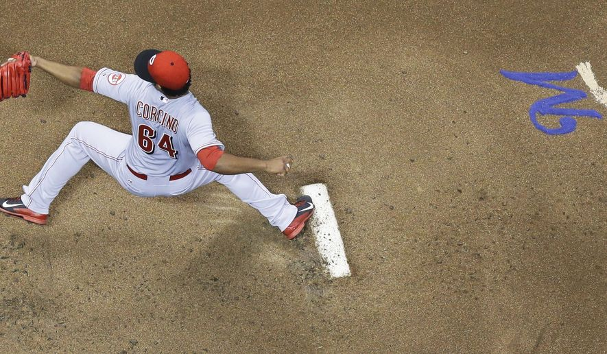 Cincinnati Reds starting pitcher Daniel Corcino throws during the first inning of a baseball game against the Milwaukee Brewers on Friday, Sept. 12, 2014, in Milwaukee. (AP Photo/Morry Gash)