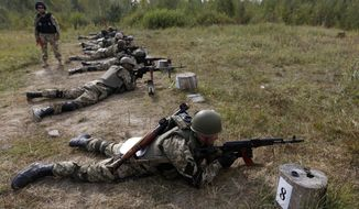 Ukrainian soldiers perform exercises at a military training centre outside Zhytomyr, some 150 km (94 miles) west of Kiev, on Sept. 11, 2014. (Associated Press) **FILE**