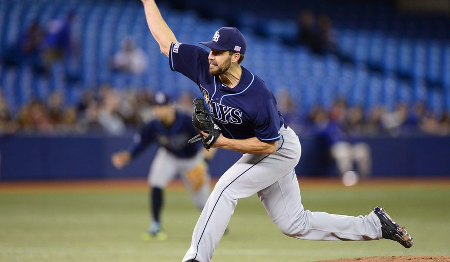Tampa Bay Rays starting pitcher Nathan Karns throws against the Toronto Blue Jays during the first inning of a baseball game Friday, Sept. 12, 2014, in Toronto. (AP Photo/The Canadian Press, Frank Gunn)