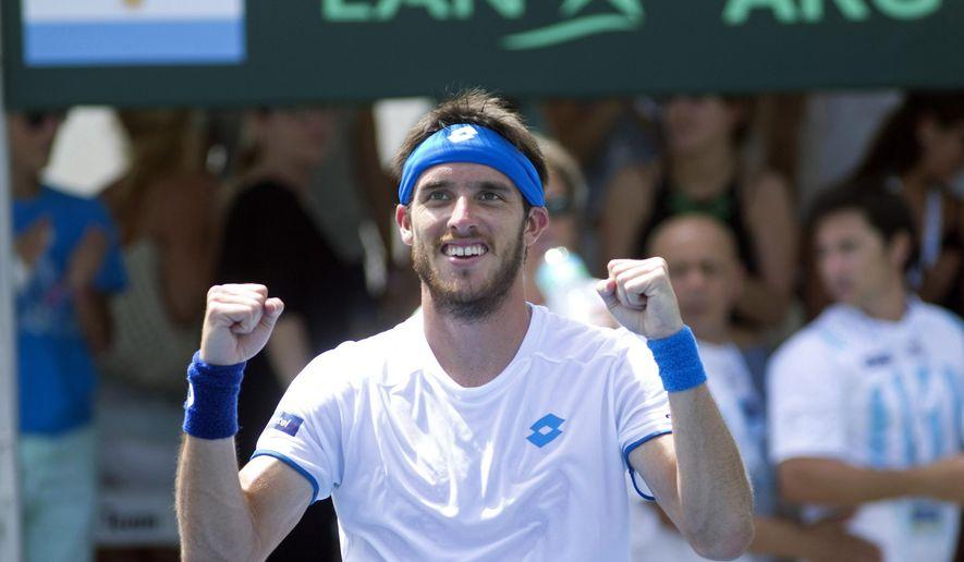 Argentina's Leonardo Mayer celebrates after defeating Israel's Bar Tzuf Botzer 6-4, 3-6, 6-2, 6-1 in a Davis Cup tennis match, Friday, Sept. 12, 2014, in Sunrise, Fla. (AP Photo/J Pat Carter)