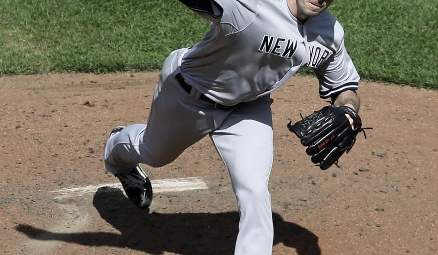 New York Yankees starting pitcher Brandon McCarthy throws to the Baltimore Orioles in the fifth inning in the first baseball game of a doubleheader, Friday, Sept. 12, 2014, in Baltimore. (AP Photo/Patrick Semansky)