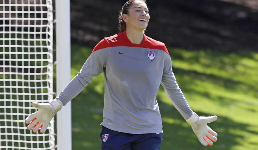 In this photo taken Wednesday, Sept. 10, 2014,  U.S. goalkeeper Hope Solo gestures during practice in Salt Lake City. The U.S. Women's National Team will play Mexico in a international friendly game at Rio Tinto Stadium, in Sandy, Utah, on Saturday. (AP Photo/Rick Bowmer)