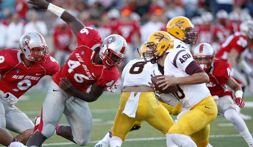 Arizona State's Taylor Kelly, right, runs away from the pressure by New Mexico's Paytron Hightower (46) during the first half of an NCAA college football game Saturday, Sept. 6, 2014, in Albuquerque, N.M.  Arizona State defeated New Mexico 58-23. (AP Photo/Ross D. Franklin)