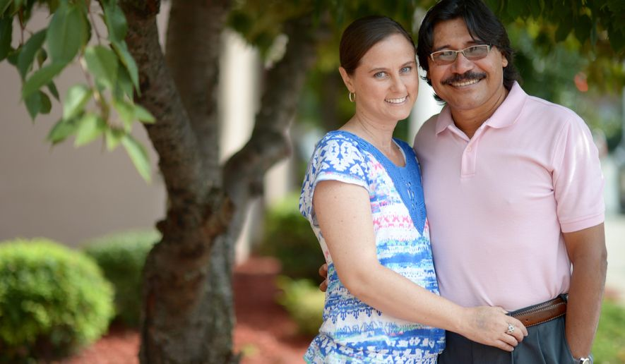 FOR RELEASE SATURDAY, SEPTEMBER 13, 2014, AT 12:00 A.M. EDT - In this Sept. 4, 2014 photo, Jorge and Karen Silva pose for a photo in Burlington, N.C. The Silvas are missonaries with Proyecto Libertad in Colombia. (AP Photo/The Times-News, Sam Roberts)