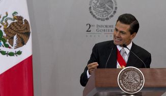 """FILE - In this Sept. 2, 2014 file photo, Mexico's President Enrique Pena Nieto gives his second state-of-the-nation address inside the National Palace in Mexico City. The Mexican president said in an interview with the newspaper El Universal published Friday, Sept 12, 2014, that Texas' decision to deploy National Guard troops along the border is """"unpleasant"""" and """"reprehensible,"""" and could affect bilateral relations. (AP Photo/Eduardo Verdugo, File)"""